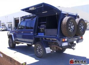 Blue Toyota Landcruiser 4