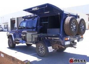 Blue Toyota Landcruiser 6